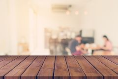 Empty wood table and Blurred background : Customer at coffee shop blur background with bokeh, Vintage toned. stock image