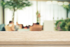 Empty wood table and blurred cafe with bokeh light background Stock Photography