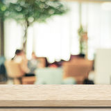 Empty wood table and blurred cafe with bokeh light background Royalty Free Stock Photo