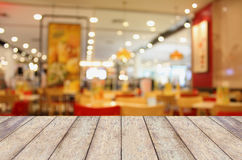 Empty wood table with blurred cafe Stock Photography