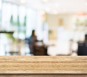 Empty wood table and blurred cafe light background. product disp Stock Image