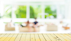 Empty wood table and blurred living room  background. Royalty Free Stock Images