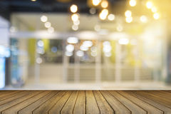 Empty wood table and blurred shopping mall in background. product display template. Business presentation Stock Images
