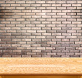 Empty wood table and brick wall in background. product display t Stock Photos