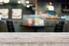 Empty wood table with cafe restaurant blur background. With bokeh Royalty Free Stock Image