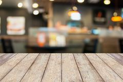Empty wood table with cafe restaurant blur background. With bokeh Stock Photos