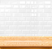Empty wood table and ceramic tile brick wall in background. prod Stock Images