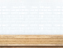 Empty wood table and ceramic tile brick wall in background. prod. Uct display template Stock Photos