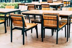 empty wood table and chair in outdoor restaurant stock photo