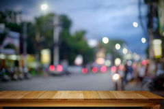 Empty Wood table with City night background. For product display montage Stock Photography