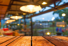 Empty wood table and Coffee shop blur background with bokeh imag Stock Photo