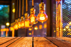 Empty wood table and Coffee shop blur background with bokeh imag Royalty Free Stock Photography
