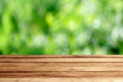 Empty wood table with garden summer bokeh outdoor theme backgrou. Nd Royalty Free Stock Photos
