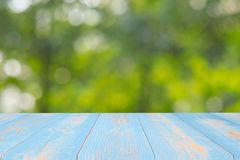 Empty wood table on green natural background in the garden outdoor. Mock up for your product display or montage stock photos
