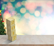 Empty wood table Happy New Year 2017 on cristmas bokeh wall. Stock Photos