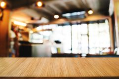 Empty wood table with montage blurred coffee cafe background stock photos