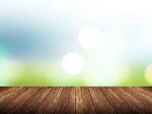 Empty wood table over blurred green nature with bokeh background Royalty Free Stock Photo