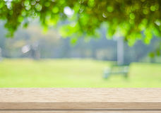 Empty wood table over blurred trees with bokeh background. Product display royalty free stock photography