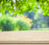 Empty wood table over blurred trees with bokeh background. Product display stock photo