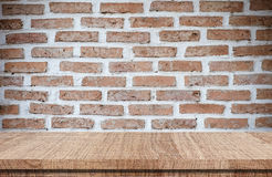Empty wood table over brick wall background, product display Stock Photo
