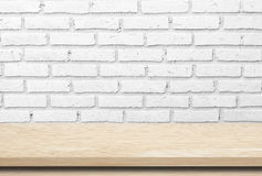 Empty wood table over whte brick wall. Stock Image
