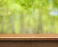 Empty wood table for product display on green Stock Photos