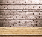Empty wood table and red brick wall in background. product displ Stock Images
