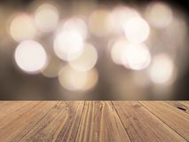 Empty wood surface with backdrop blurred bokeh lights background, product display. Empty wood table or shelf with backdrop blurred bokeh lights, product display royalty free stock photography