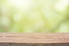 Empty wood table with sunlight bokeh background. stock photo