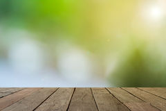 Empty wood table with sunlight bokeh background Royalty Free Stock Photo