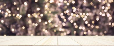 Empty wood table top with Abstract blur Christmas tree stock photo