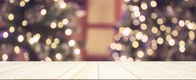 Empty wood table top with Abstract blur Christmas tree stock photography