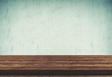 Empty wood table top on blue concrete background royalty free stock photography