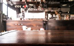 Empty wood table top with blur of abstract coffee shop or cafe. Empty wood table top with blur of  abstract coffee shop or cafe restaurant background.vintage Stock Photography