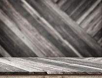 Empty wood table top with blur diagonal wood wall. Stock Images