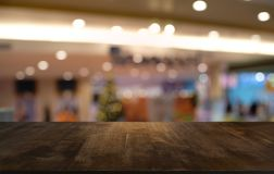 Empty wood table top and blur of night market background/selective focus .For montage product display. Empty wood table top and blur of night market background/ stock image