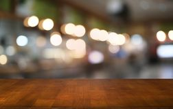Empty wood table top and blur of night market background/selective focus .For montage product display. Empty wood table top and blur of night market background/ royalty free stock photo