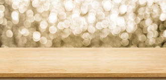 Empty wood table top with blur sparkling gold bokeh abstract bac Royalty Free Stock Photos