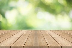 Empty wood table top on blurred abstract green background Stock Images