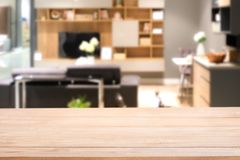 Empty wood table top with Blurred abstract mock up of modern living room interior stock image