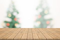 Empty wood table top on blurred background from christmas tee Stock Images