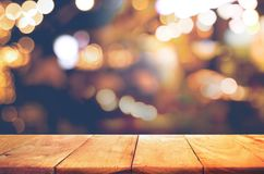 Empty of wood  table top with  blurred light gold bokeh abstract. Background.For montage product display or design key visual layout Stock Photo