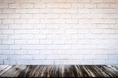 Empty wood table top and brick background with copy space. Royalty Free Stock Image