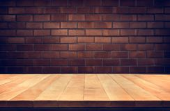 Empty wood table top with Brown brick wall background. Product display Royalty Free Stock Image