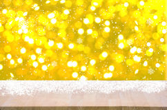 Empty wood table top on gold bokeh light christmas background. With snowfall. for product display montage Stock Photo