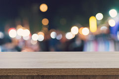 Empty wood table top for product display montage and blurred bokeh night. royalty free stock photography
