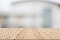 Empty wood table top on white blurred background from building Royalty Free Stock Photo