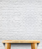 Empty wood table and white brick wall in background,Mock up temp. Late for display of product,Business presentation Royalty Free Stock Images