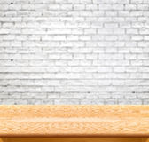 Empty wood table and white brick wall in background. product dis Stock Images