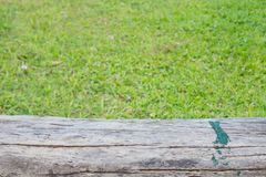 Empty wood top with green grass field natural park royalty free stock photography
